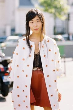 Her new tribe tumblr. Orange leather skirt, black lace top and embellished white coat