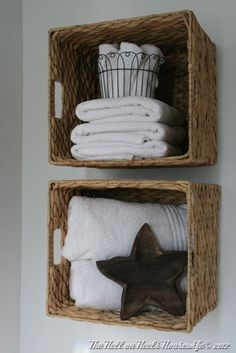 baskets nailed to the wall as bathroom storage