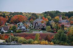 Bayfield Apple Festival: a view from the ferry shows Le Chateau amidst the splendor of fall color. #bayfieldapplefest