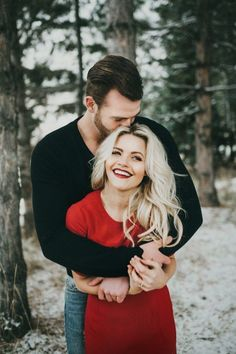 Witney Carson Engagements pictures. beautiful couple photos winter and i like her pop of red