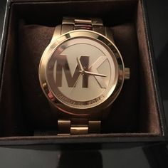 Gold Michael Kors Watch this authentic michael kors watch is in excellent condition! rarely ever worn! has no scratches on the screen! original box and extra links so it can be adjusted for your own wrist! Michael Kors Accessories Watches