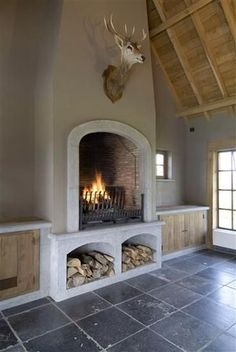 Rounded fireplace with wood storage. Kitchen Fireplace, Decor, Home Fireplace, Home, Wood Storage, House Design, Fireplace Design, Fireplace Decor, House Interior