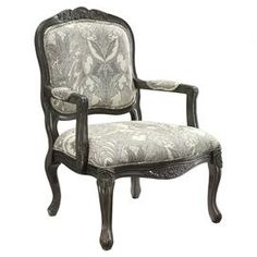 Hand-carved wood arm chair with cabriole legs and paisley-print upholstery.  Product: ChairConstruction Material: Wood and fabric Color: Black, grey and whiteFeatures: Paisley designDimensions: 39.25 H x 26.76 W x 28.75 D