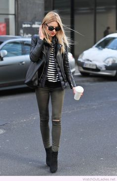 Black leather jacket, skinny ripped grey jeans, black and white striped top and black booties