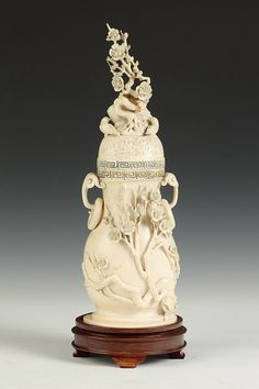 CHINESE IVORY VASE. Of pear shape carved with a prunus flowering branch on body and finial - 13 in. high.  Notes: Provenance: Private collection of David G. Tarlow, acquired in the 1960s.