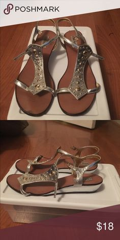 Steve Madden Silver sandals Metallic silver sandals with gold round studs. Low wedge heel. Steve Madden Shoes Sandals