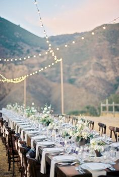 dining under cafe lights | Photography by bwrightphoto.com | Design, Planning, Florals + Invitations by gatherevents.com |  Read more - http://www.stylemepretty.com/2013/07/12/figueroa-mountain-farmhouse-wedding-from-b-wright-photography-gather-events/