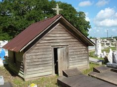 Another Grave House, Istre Cemetery,  Morse, Louisiana. They were built over in-ground tombs, constructed with detailed windows, hinged doors, working locks and more.