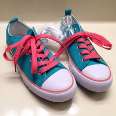 💋FLASH SALE💋 NEW blue and pink sneakers! Brand new, never worn blue and pink sneakers. So cute and such bright colors! Women's size 7.5. They come with a spare pair of white laces as shown in the picture. Buy 3 or more items from my closet to get my seller discount added to your order at checkout! ☺️ Shoes Sneakers