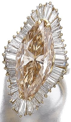brown-yellow marquise-shaped diamond weighing 12.22 carats.