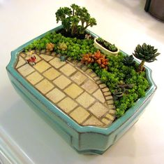 Tiny miniature fairy garden with a pretty patio