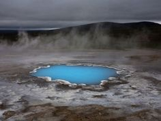 oh my... iceland. a hot water pond, charged with silica. glowing. amazing. (by david remacle)