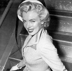 """Marilyn Monroe photographed before boarding a plane at Queens airport for the promotional tour of """"Monkey Business"""", 1952."""