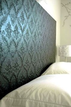 Gorgeous color and texture: Textured wallpaper applied to a sheet of wood and painted. DIY headboard. Idea: Use a door, and add only to inset of door.