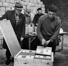 From U.S.-Bound for German Prison Camps. The International Red Cross at Geneva, Switzerland opens a crate containing Christmas packages addressed to British prisoners of war in German camps. The packages will arrive many months late. These particular packages come from America. There were over 100,000 of these packages to distribute. An indication of the activity of the Red Cross here, is given from the fact that 60,000 letters are handled daily compared to 25,000 during WWI.