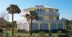 This elevated two-story home on the coast of South Carolina was built on pilings with breakaway flood walls on the ground level.  It was designed to be hurricane-proof and features floor-to-ceiling windows and wrap-around decks on both living levels, making it the perfect beach house.  View our online elevated hurricane home designs - http://www.topsiderhomes.com/piling-pier-stilt-house-hurricane-home-plans.php   #topsiderhomes #hurricanehomes #homedesigns #elevatedhomes #stilthomes