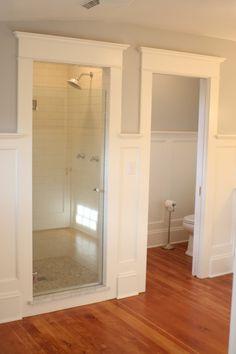 Walk in shower with frameless glass door.