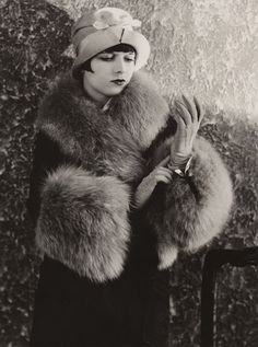 """""""A well dressed woman, even though her purse is painfully empty, can conquer the world.""""  ~ Louise Brooks"""