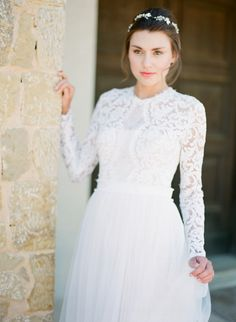 Dreamy lace + tulle long sleeve wedding dress: http://www.stylemepretty.com/2016/07/25/white-on-white-greek-wedding-inspiration/ | Photography: Vasia Photography - http://www.vasia-weddings.com/