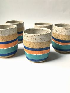 "measures approx 3.5"" tall and 3"" wide at opening. We use only Lead Free glazes. All of our products are food/microwave/dishwasher safe. This set of mugs have been hand formed by me on the potters whee"