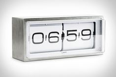 Brick Flip Clock.  I guess the staionles steel case makes it worth the $350 which is about $325 more than similar looking ones on Amazon.  Still. It's one of my favorite kinds of clocks.