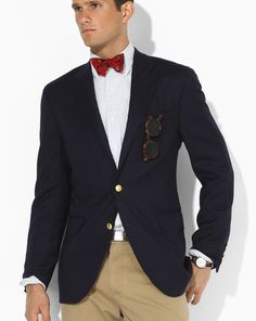 Navy Blazer, Red Bow tie, Tortoise Shell Glasses.