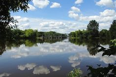 """Check out my art piece """"Speed River Dam"""" on crated.com - Speed River Guelph Ontario Canada #art #photography #river #dam #clouds #reflections"""