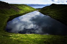 Heart-shaped Lake Full of Clouds Pointing Down to the Sea, Scotland. Photo by Giorgio Raffaelli