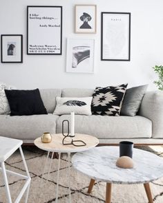 Scandi design ideas for a neutral and chill living room. A coffee table cluster is such a functional solution for entertaining - pull a table here or there as needed. Love the mix of pillows and a neutral low shaggy rug. Minimalist gallery wall idea. how to style a living room. what to put on a coffee table