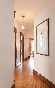 Junction - Benjamin Moore Oxford White (coexisting nicely with their Cloud White elsewhere) Stained Wood Trim, Dark Wood Trim, Dark Wood Floors, Natural Wood Trim, Wood Flooring, Dark Baseboards, Wood Baseboard, Interior Trim, Interior Design