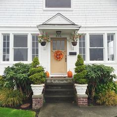 Cute house with pumpkins and a fall wreath