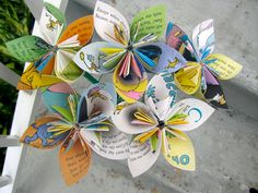 The book pages as petals is a cute idea. Pastel colors or paper with colored pastel patterns would be nice too :)