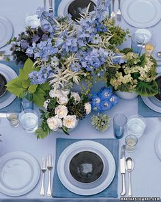 Actually an assemblage of several smaller and more manageable arrangements, the setup offers an easy way to tame a fresh-from-the-garden mix of roses, hydrangeas, delphiniums, lady's mantle, scented geraniums, and potato vine. A pitcher in the center gives height, while kitchen crocks (sugar bowls, eggcups) allow the inclusion of short-stemmed beauties.