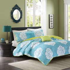A plush coverlet is graced with a teal background and accented with a white damask motif to create this contemporary reversible bedding set. Machine washable for easy clean up, this engaging set is complete with matching shams and decorative pillows.