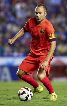 Andres Iniesta of Barcelona runs with the ball during the La Liga match between Levante UD and FC Barcelona at Ciutat de Valencia on September 21, 2014 in Valencia, Spain.