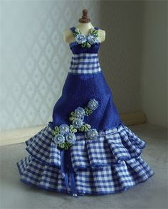 Royal Grace. beautiful royal blue dupion silk ballgown with royal blue and white double pleated ribbon ruffle to the hem and waist. Kissed with embroidered roses with genuine swarovski crystal centres. Created on a top quality mannequin.