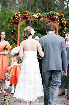 Fall outdoor wedding arbor. J Crew tea length dress. Cleopatra Photography