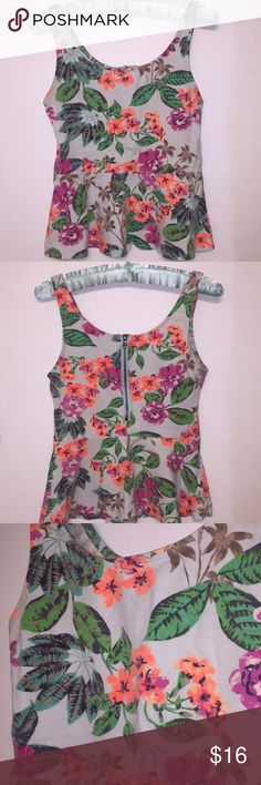 Beautiful floral sleeveless top From express size petite small. Fabric has stretch to it. Beautiful design. I loved this top but it no longer fits :( I want somebody else it love it like I did Express Tops Tees - Short Sleeve