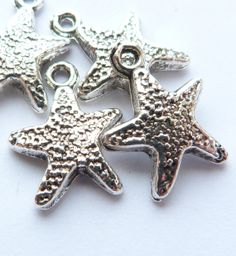 Starfish Charms Shiny Silver Tone Set of 4. by TheBlueBeadle, $2.49
