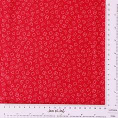 Divertida tela rosa con dibujos de símbolos de lavado. Tela de patchwork en oferta :-)