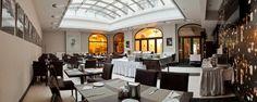 Notre hotel met a votre disposition un Cafe Bar, donc l'athmosphere et le design change souvent grace a des artistes contemporains. Notre carte est composée de délicieuses spécialitée de café, de cocktails (avec ou sans alcool), d'une grandes variété de boissons internationales, ainsi que pour les amoureux de thé un large choix saveurs que nous vous invitons a déguster durant votre séjour á Budapest.  Horaires de l'ouverture:  Mardi – Samedi: 14:00-22:00