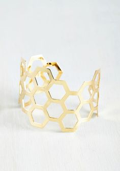 Sweet Like Honeycomb Bracelet. Add sweet shining style to your ensemble with  this gold cuff 4501d57e59f0