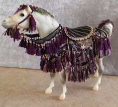 Breyer Classic Arabian Stallion. Dressed in gorgeous plum, black and gold, authentic vintage costume. Special offering for the horse lover in your family.. $159... www.ruthellens.faithweb.com