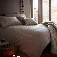 Make your bedroom feel like a home with a touch of rustic style from this natural 'Sprig embroidery' bed linen, from Rocha.John Rocha at Debenhams, which combines white embroidered floral motifs with contrasting earthy natural brown. Now snuggle up and wait for winter! From £28.