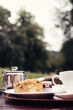 Tea and scone with clotted cream and jam from Downtown Abbey Castle in England