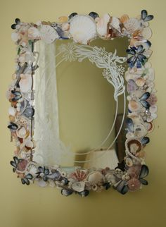 This gorgeous, vintage mirror was given to me by my Beloved Mother. It has beautiful etching around the perimeter of the mirror. I have added lots of beautiful natural colorful seashells, mussell shells, scallops shells, along with a few crystal pearls for accent.  This mirror would add sparkle to any room !!!!!!  This mirror is not for sale, but it is an example of custom mirrors that I can create for you