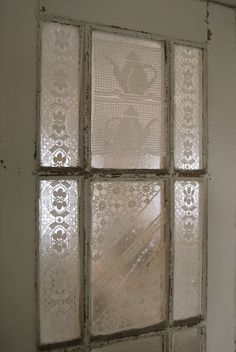 old lace tableclothes cut to fit and cover old window panes (or china cabinet doors, or in place of frosting bathroom window,... so many possibilities!)
