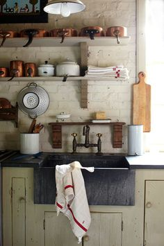 open shelving, copper pots, that amazing sink