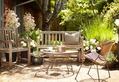 How to Clean and Care for Wood Outdoor Furniture. Patio with weathered teak furniture, Gardenista