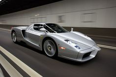 Silver Ferrari Enzo...would cool to get behind the wheel just once.